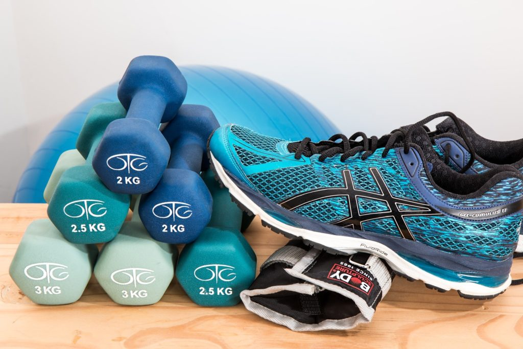 dumbells and running shoe