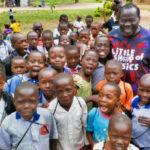 Teacher with children in Uganda