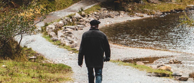 man walking on winding road