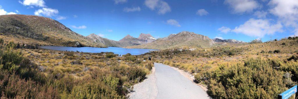 Road running through mountains to lake