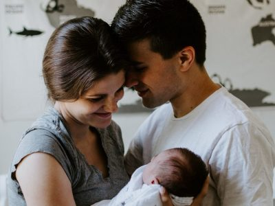 Mother and Father holding new baby